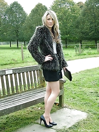 Sexy Kim posing outdoors in a fur coat and some sexy high..