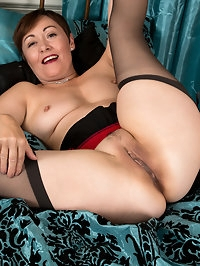 Hot mom Kitty Creamer is decked out in lingerie that makes..